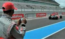 Lewis Hamilton controls F1 car with a Blackberry video