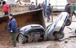 Giant pothole swallows three cars and a truck