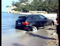 BMW X5 buried in Turkish beach sand