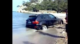 BMW X5 buried in Turkish beach sand