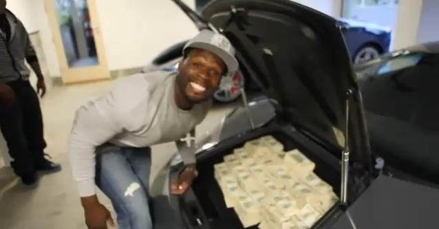 Video: 50 Cent stacks 2 Million USD in his Lambo