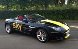 Chris Froome receives a Jaguar F-Type