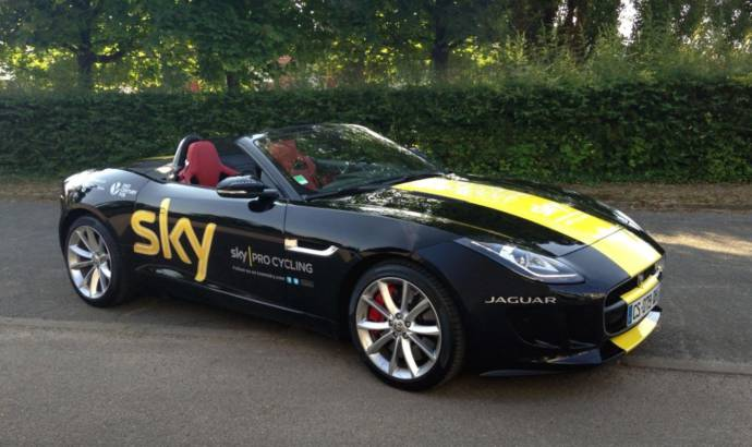 Chris Froome receives a Jaguar F-Type