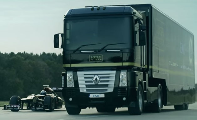 Lotus F1 Team truck jumps over Formula 1 car