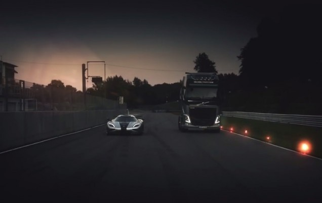 Volvo FH Truck on the racetrack against Koenigsegg One 1