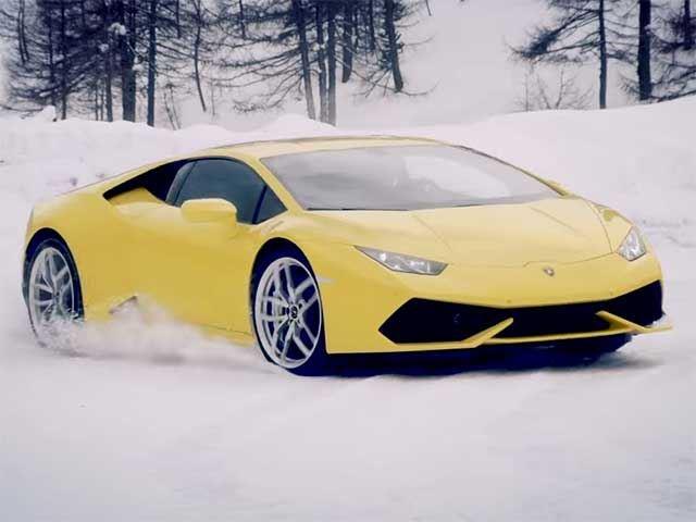 Lamborghini Huracan racing a snowmobile
