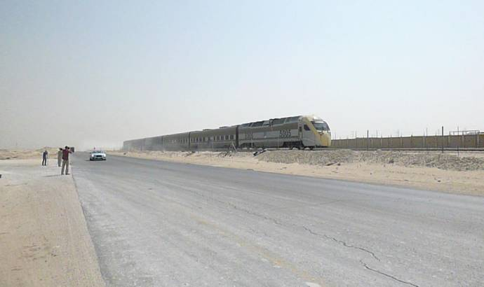 Bentley Continental GT V8 S Convertible races a train in the desert