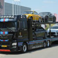MAN truck in Martini Racing livery for transporting Porsche cars