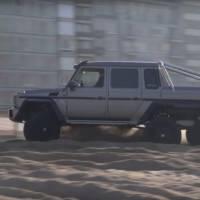 Mercedes G63 AMG 6x6 power sliding on a Belgium beach