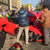 Ferrari LaFerrari hits three parked cars