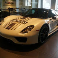 A Porsche 918 Spyder was stolen from a dealer. In broad daylight