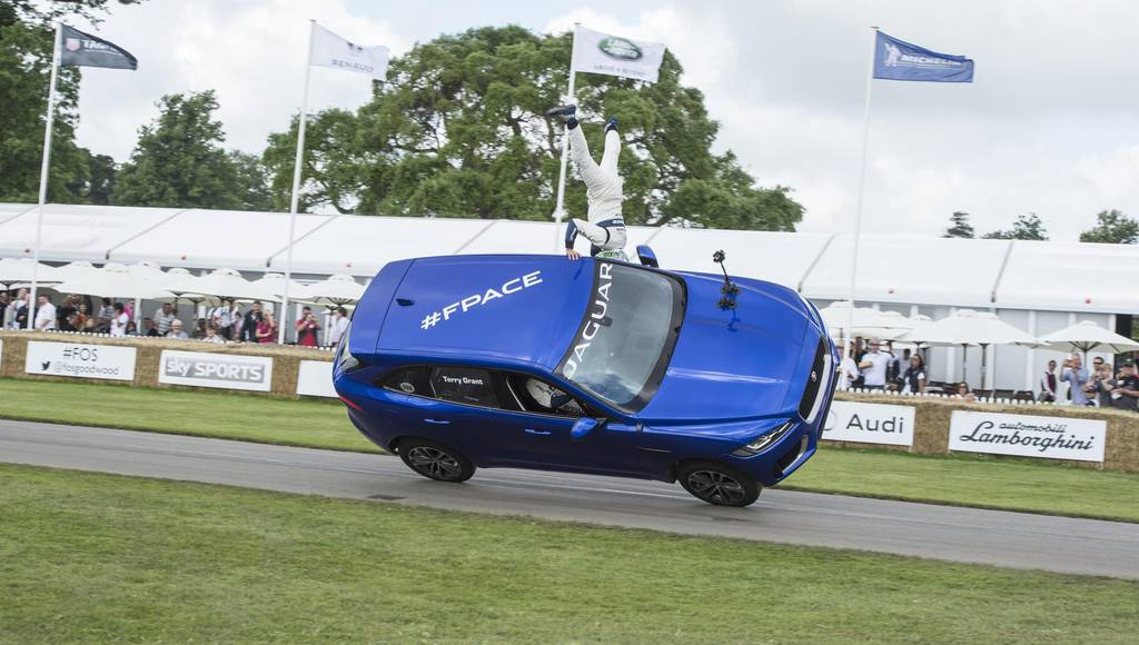Jaguar F-Pace SUV rides on two wheels at Goodwood