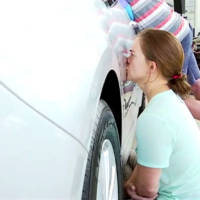 Seven people kissed an Optima for 50 hours. Only one has win it!
