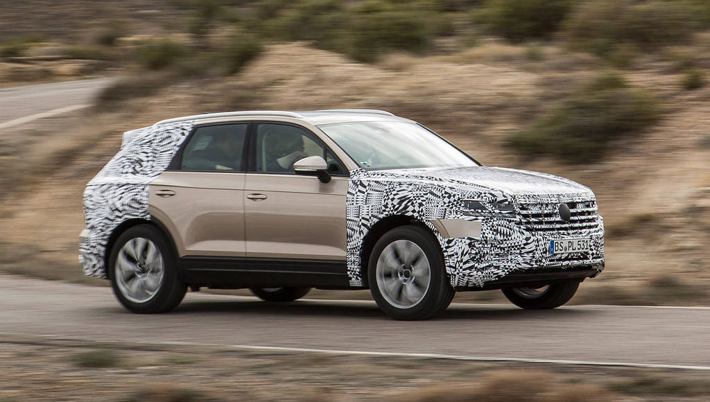 The new generation Volkswagen Touareg teased on its way to Beijing