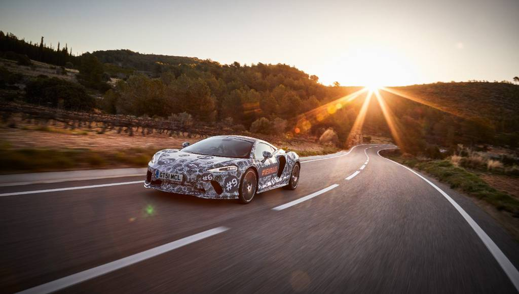 Upcoming McLaren Grand Tourer teased with some camouflaged pictures